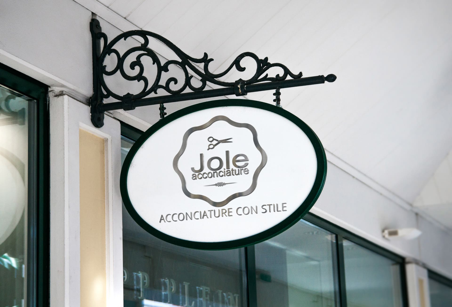 acconciature jole Hanging-Wall-Sign